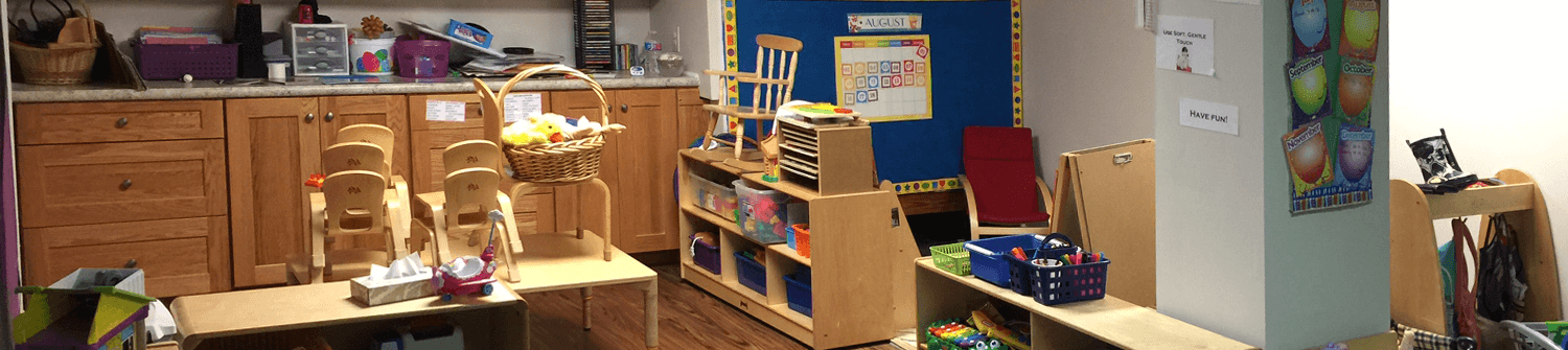 the interior of a daycare with new solid wood cherry cabinets