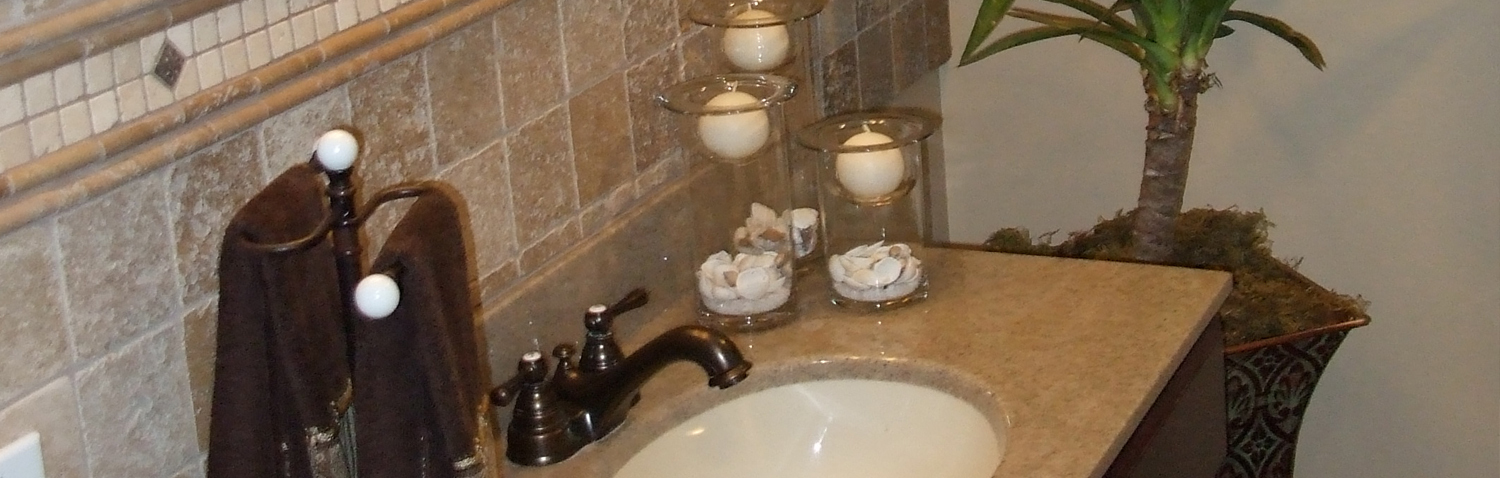 renovated bathroom with new countertops, sink fixture faucet and backsplash