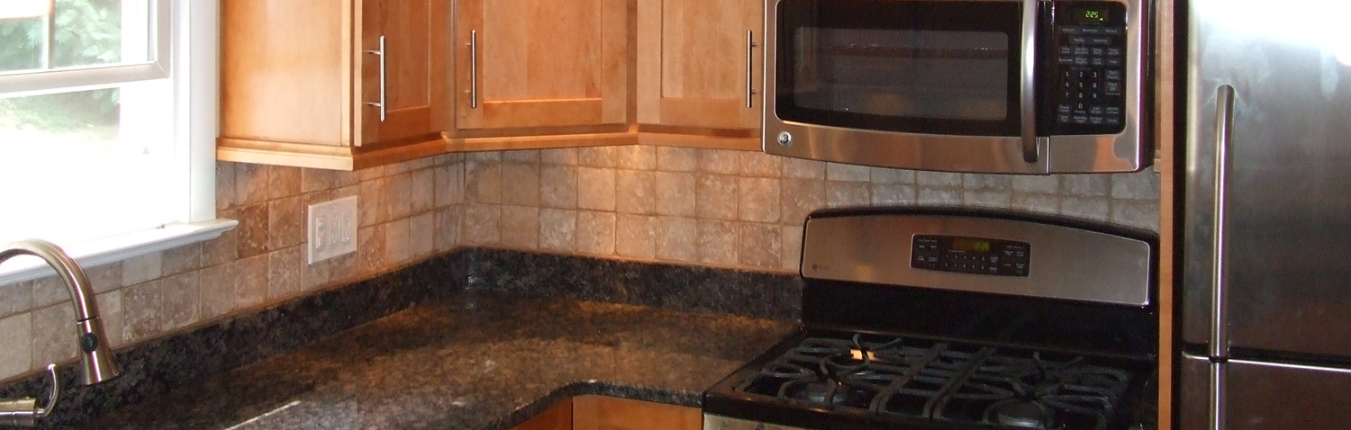 remodeled kitchen with new kitchen cabinets, countertops and backsplash