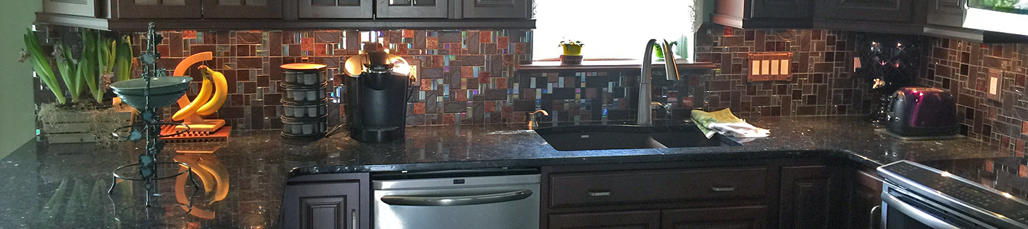 remodeled kitchen cabinets, back splash, and countertops